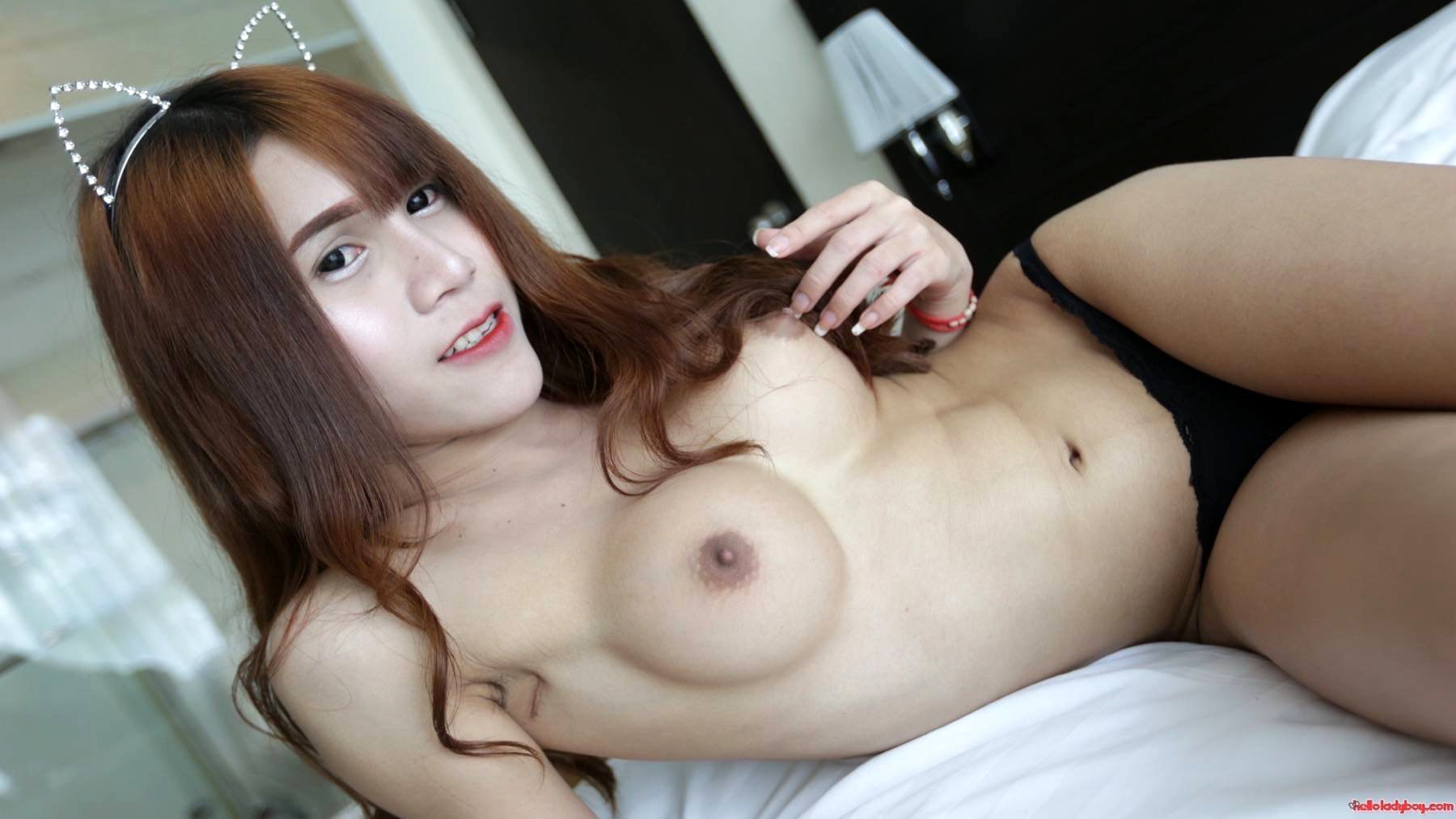 18 Year Old Sensuous Asian With Long Red Hair And Busty TGirl Strips