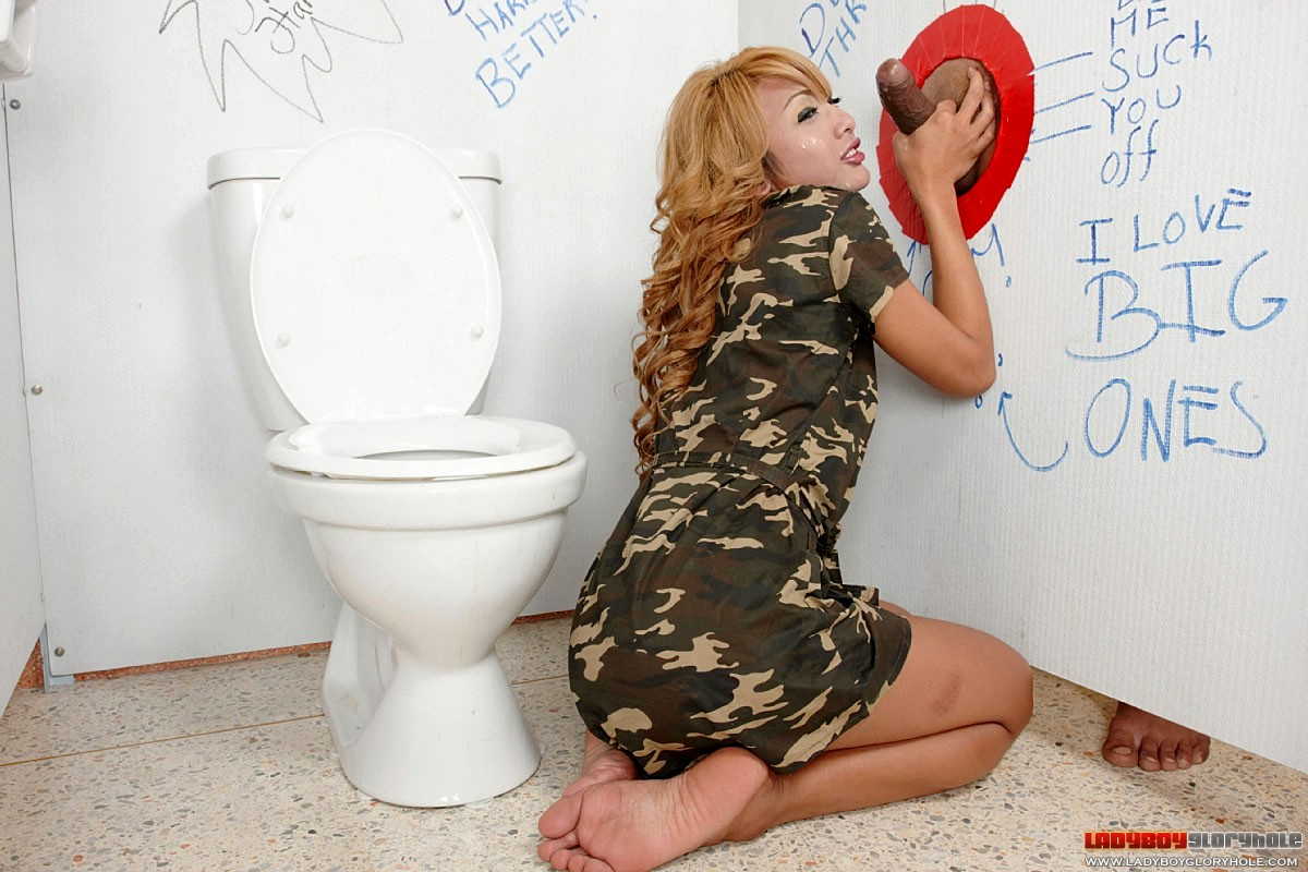 Army Tgirl Eating Cock Tool Through Gloryhole