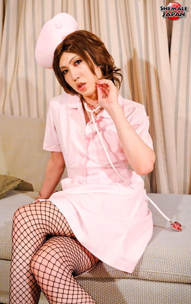 Japanese Tgirl Nurse Strips Before Cameraman