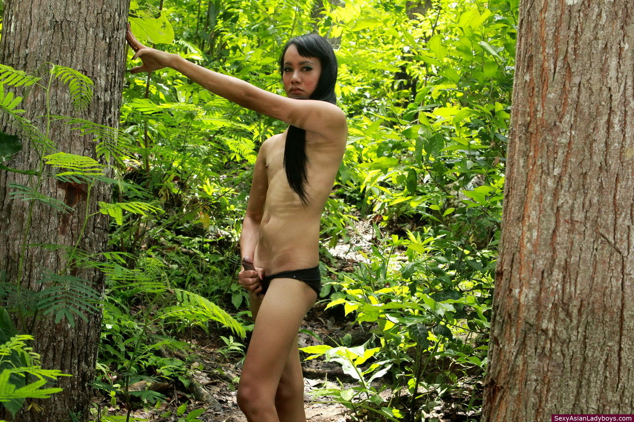 Long Haired TGirl Walking And Jerking Her Penis In A Tropical Forest