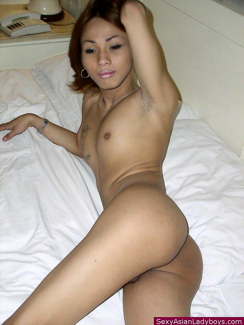 Slender T-Girl Stripping On His Bed For Our Voyeuristic Pleasure