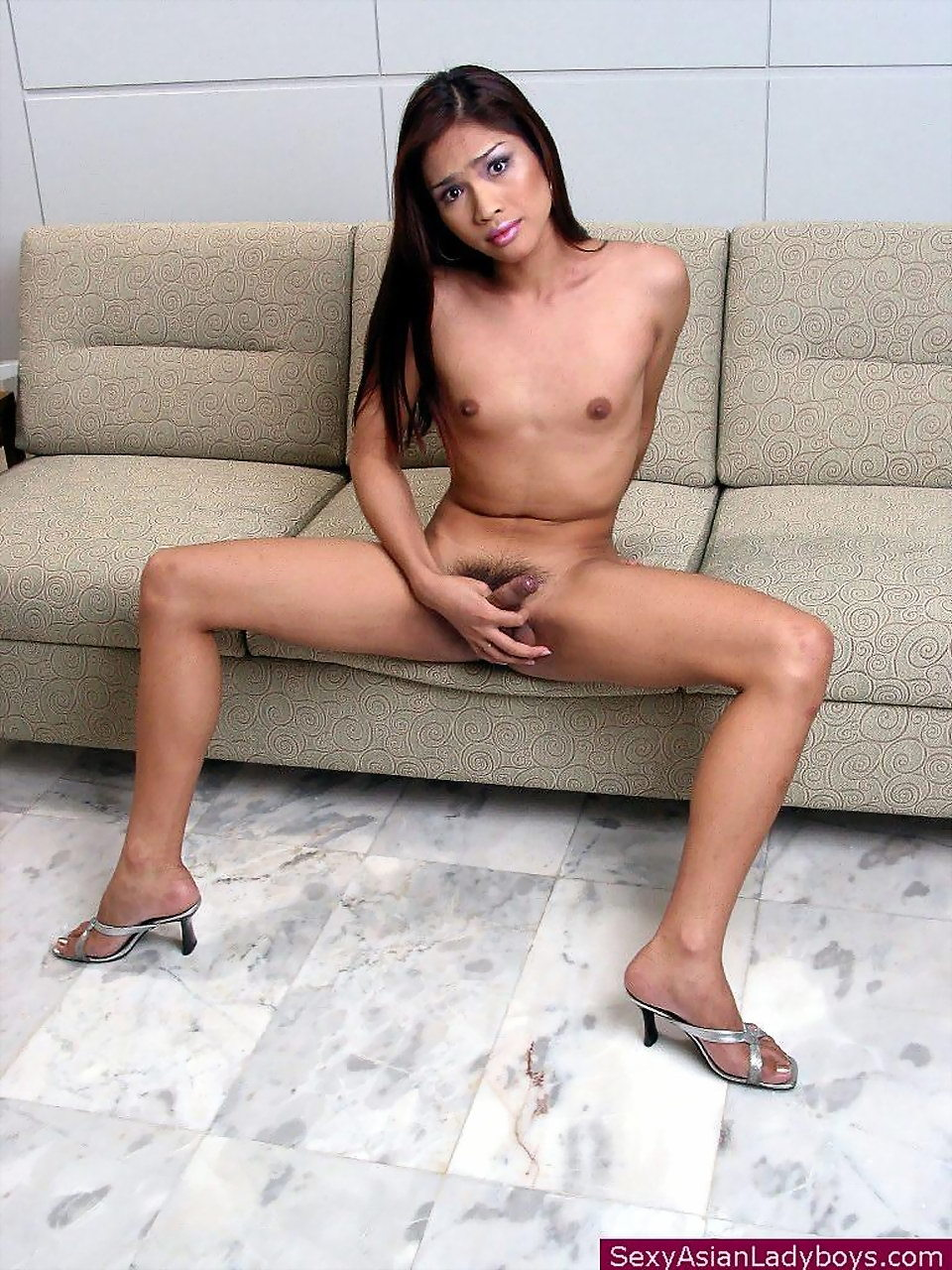 Thai Trannie Stripping And Playing With Her Hardon