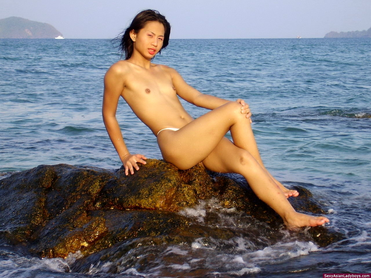 Provoking Little Shemale Stripping And Flashing Her Hot Body On A Tropical Beach