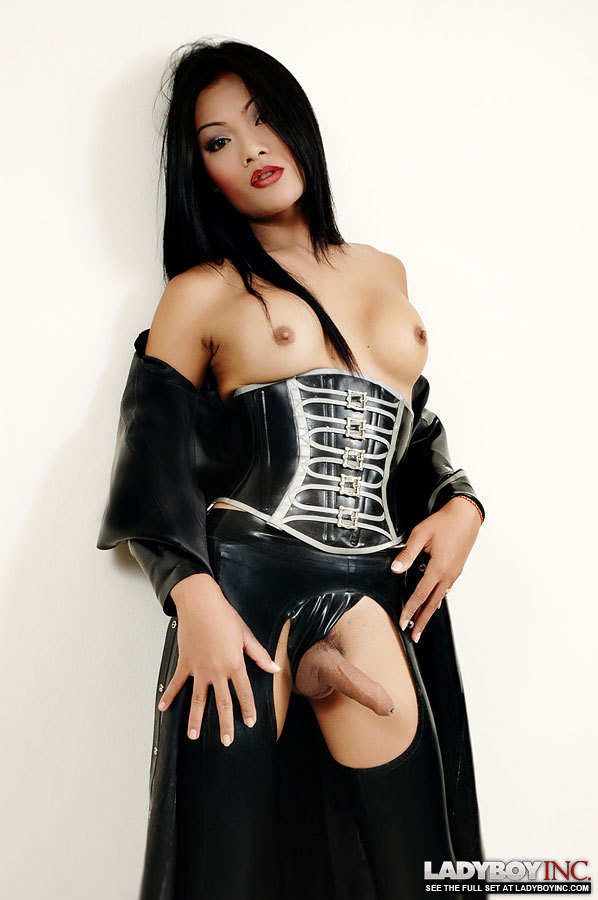 Transexual In Latex Flashes Off Her Raw Dick